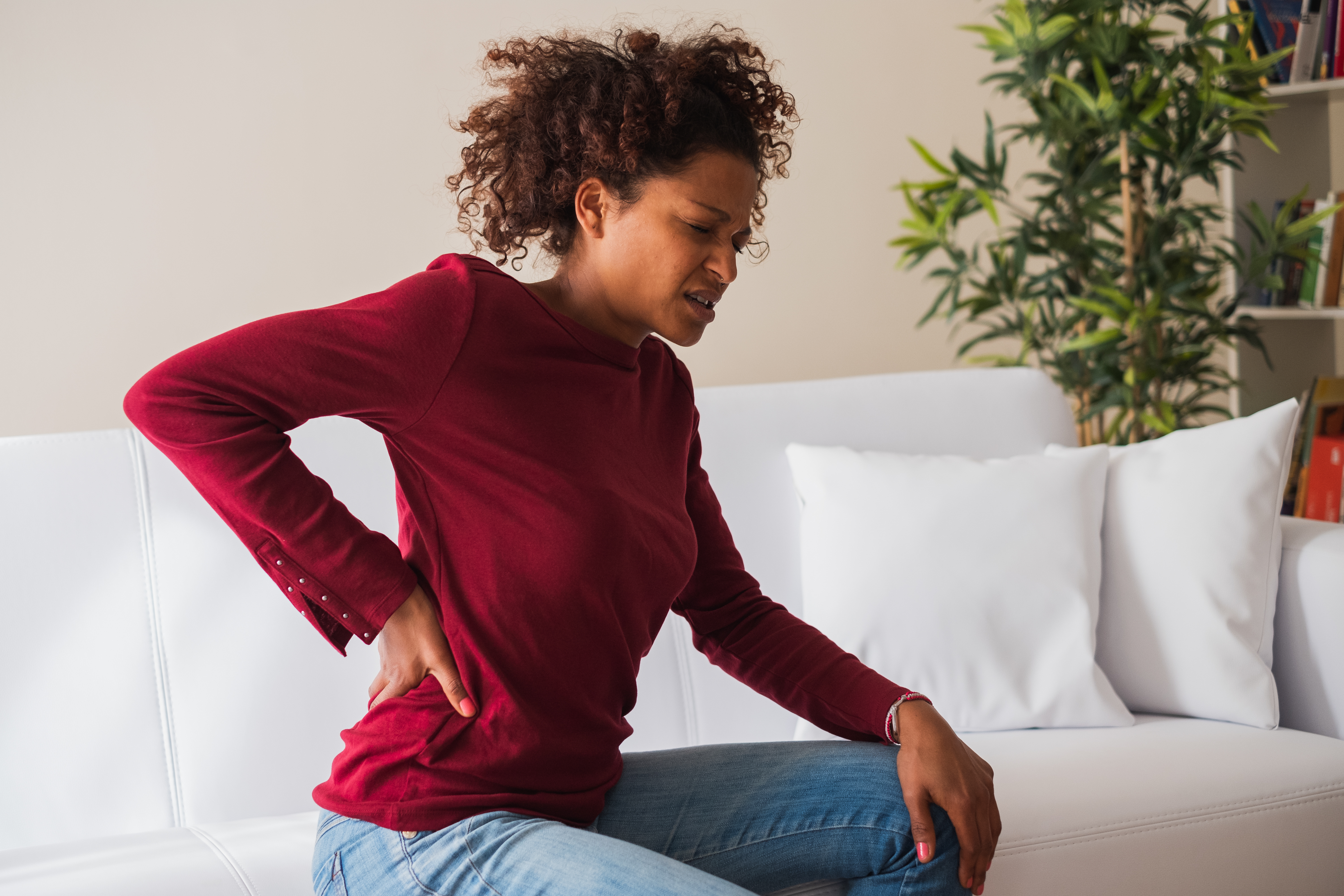 Woman on couch with back pain