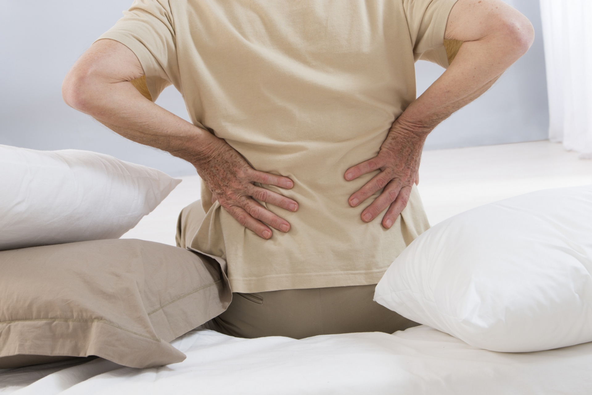 Man touching back in pain