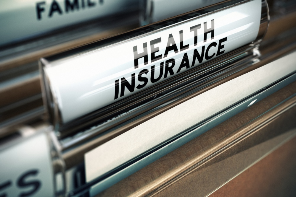 filling cabinet with folder on private health insurance