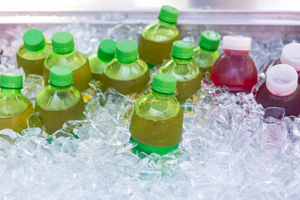 Energy drinks resting in a pool of ice